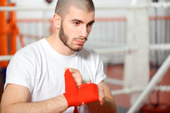 Sportsman binds boxing bandage Royalty Free Stock Photography
