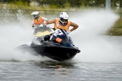 Sportsman in black jetski royalty free stock image