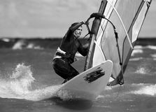 The sportsman on a board. For surfing carries out turn Stock Photography
