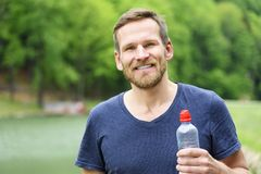 Sportsman with a bottle of water Royalty Free Stock Image