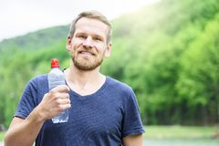 Sportsman with a bottle of water Stock Images
