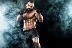 Sportsman boxer fighting on black background. Copy Space. Boxing sport concept. Stock Photo