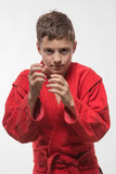 Sportsman boy brunette in a red kimono Royalty Free Stock Photos