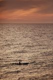 Sportsman on canoe on sunset Royalty Free Stock Photo
