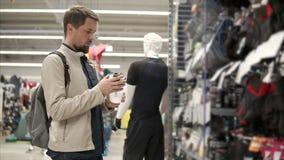 Sportsman checks on a new sports bottle. stock footage