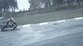 Sportsman comes in abrupt turn on a slippery road stock footage