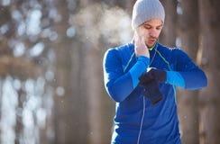 Sportsman control heart beats on training. Sportsman control heart beats on cardio training in nature stock photos