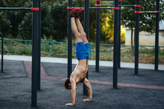 Sportsman at crossfit ground doing push ups as part of training. Sport concept. Muscular man at crossfit ground doing push ups as part of training. Sport concept royalty free stock photos