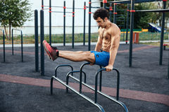 Sportsman at crossfit ground doing push ups as part of training. Sport concept stock images