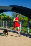 Sportsman and dog running Royalty Free Stock Photos