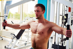 Sportsman is doing chest workout on the machine in gym Royalty Free Stock Photo