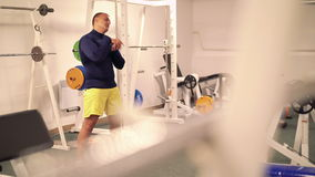 Sportsman doing exercise for stretching in the gym 4k stock footage