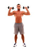 Sportsman doing exercises with dumbbells Royalty Free Stock Photos