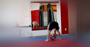 Sportsman doing exercises. In gym studio stock footage