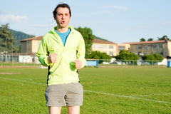 Sportsman doing exercises in a soccer field Stock Image