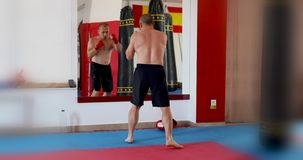 Sportsman doing exercises. In gym studio stock video footage