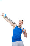Sportsman doing fitness exercises with expander. Cheerful sportsman doing fitness exercises with expander over whtie background Royalty Free Stock Photos