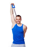 Sportsman doing fitness exercises with expander stock image