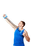Sportsman doing fitness exercises with expander Royalty Free Stock Images