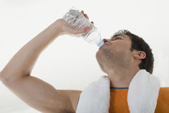 Sportsman drinking water Stock Image