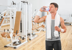 A sportsman drinking water from bottle Stock Image