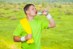 A sportsman drinking water from bottle Royalty Free Stock Photography