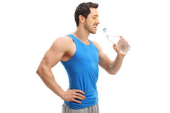 Sportsman drinking water from a bottle Royalty Free Stock Photos