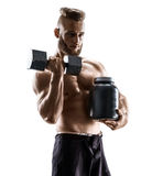 Sportsman with dumbbell and large bank with protein in hand. Stock Photos
