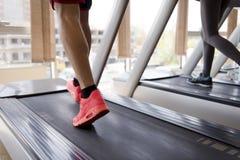 Sportsman exercise jogging on treadmill Stock Photos