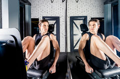 Sportsman exercising in gym Stock Images