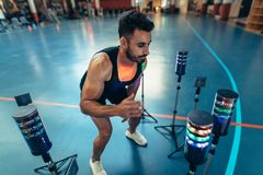 Athlete using visual stimulus system at sports lab. Sportsman exercising with lights around to improve reaction time at gym. Athlete using a visual stimulus Royalty Free Stock Image