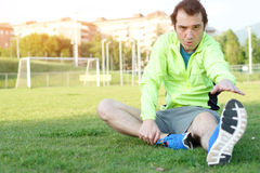 Sportsman exercising in a soccer field and preparing Royalty Free Stock Photography