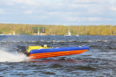 Sportsman fast  at power boat on river Stock Photography
