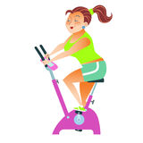Sportsman girl exercise bike. The girl with more weight training on a stationary bike royalty free stock photography