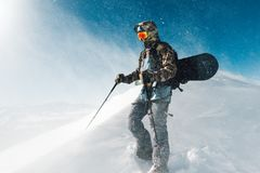 Sportsman go with snowboard equipment in the snowstorm Royalty Free Stock Photo