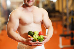 Sportsman with healthy food Royalty Free Stock Photo