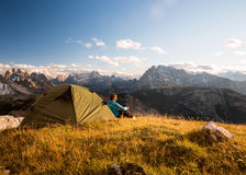 Sportsman in high mountains camping Stock Image