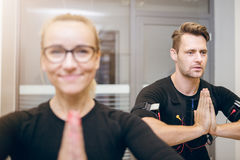 Sportsman and his coach in yoga pose Stock Photography