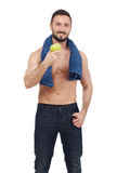 Sportsman holding an apple Royalty Free Stock Images