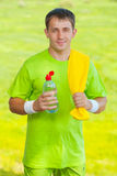 A sportsman holding bottle of water and looking at camera Stock Photography