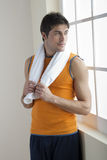 Sportsman holding towel Royalty Free Stock Photos