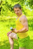 A sportsman holding weights Royalty Free Stock Images