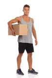 Sportsman Holds Delivery For You Royalty Free Stock Images