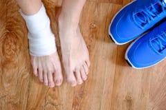 Sportsman injured foot Stock Photos