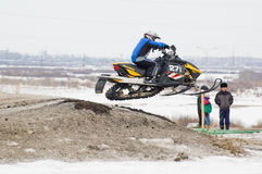 Sportsman jump on snowmobile Royalty Free Stock Image