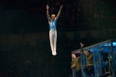 """The sportsman in a jump on a trampoline. MOSCOW, RUSSIA - NOVEMBER 16-17, 2018: Gymnasts performance at the """"Legends of Sport"""" show by Alexey Nemov stock photos"""
