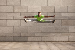 Sportsman jumping with spread legs Stock Image