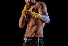 Sportsman kick boxer portrait against black background. Royalty Free Stock Photography