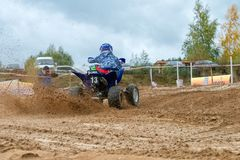 The sportsman leaves chase. SERPUKHOV, RUSSIA - OCTOBER 7, 2017: Nikolaev Maksim 13, Class ATV-JUNIORS, in the 4 stage MX series, the Red Wings Cup 2017 super stock photos
