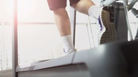 Sportsman legs running on treadmill machine in gym, goal oriented, endurance. Stock footage stock video footage